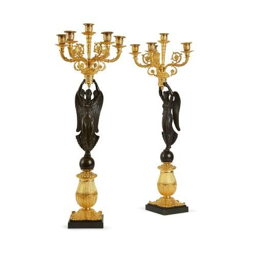 Pair of Empire period gilt and patinated bronze candelabra