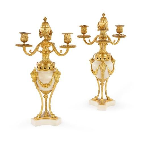 Pair of Louis XVI style ormolu and white marble cassolettes