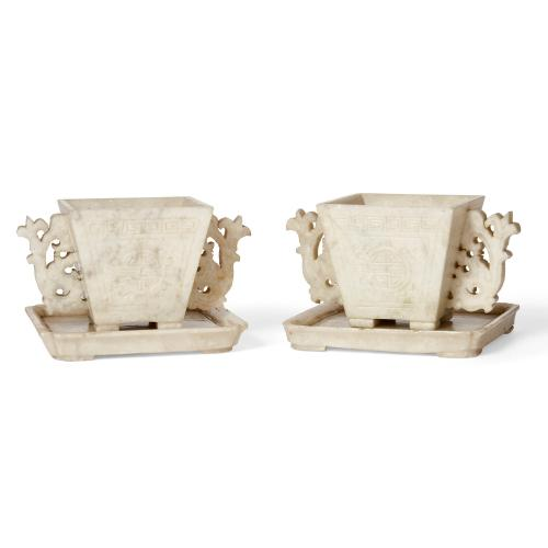 Pair of Chinese soapstone cups and saucers