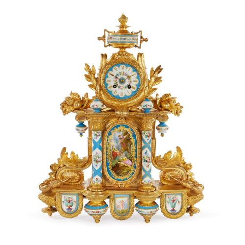 Rococo style ormolu and porcelain antique mantel clock