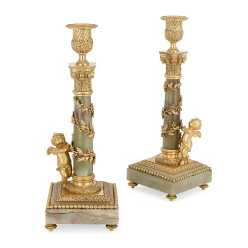 Pair of gilt metal mounted green onyx French candlesticks