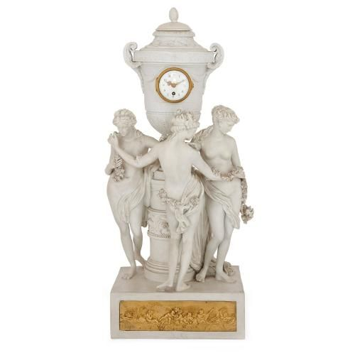 Neoclassical style porcelain mantel clock depicting the Three Graces