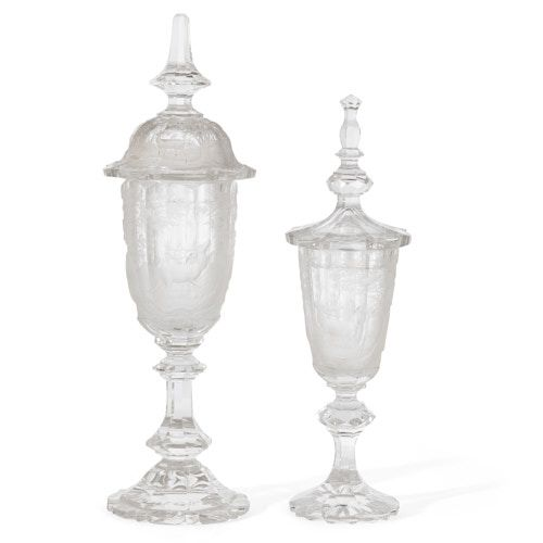 Set of two Bohemian incised glass goblets with covers