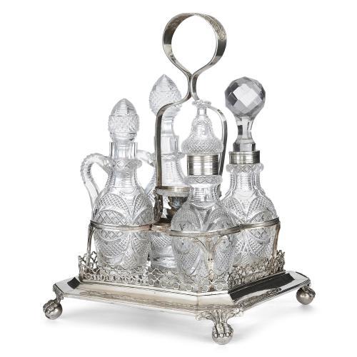 Portuguese silver cruet set with cut glass decanters