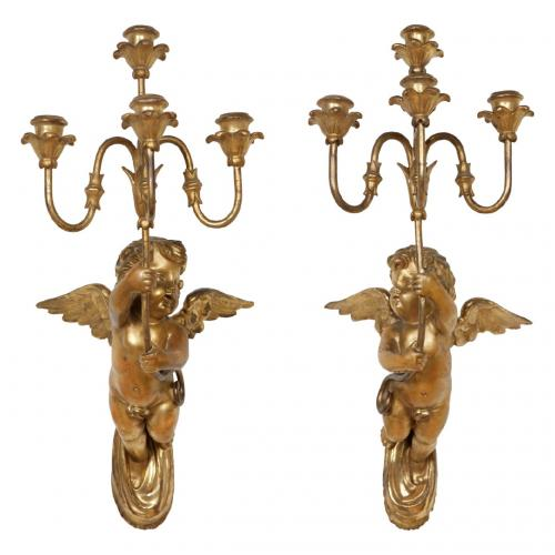A pair of carved giltwood wall lights