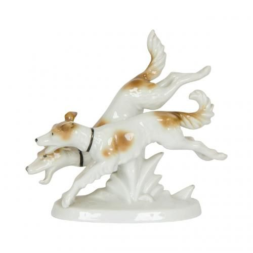 A porcelain figural group of two dogs