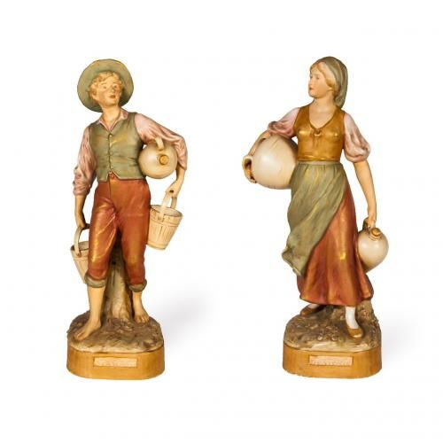 A pair of Royal Dux ceramic figures