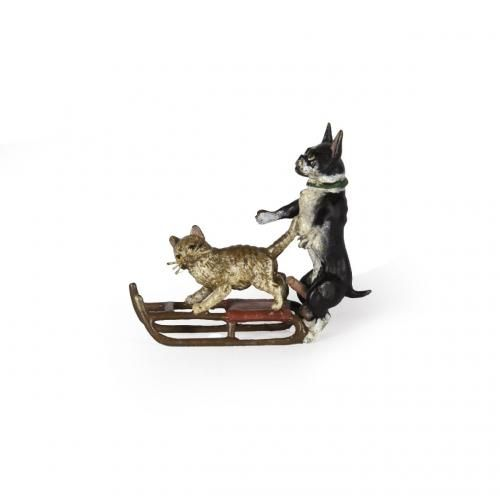 An Erotica miniature cold painted bronze group of a cat and dog