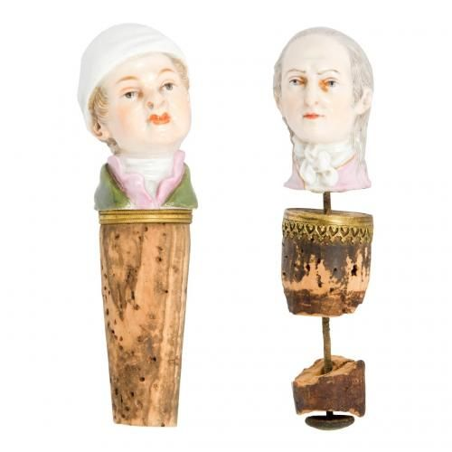 A set of two Meissen porcelain bottle stoppers in the form of male busts