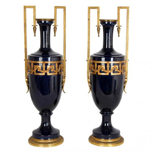 A pair of French faience blue-ground gilt metal mounted vases