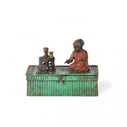A cold painted bronze box with sitting boy