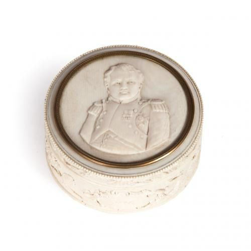 A miniature round carved ivory box with bust of Napoleon on lid