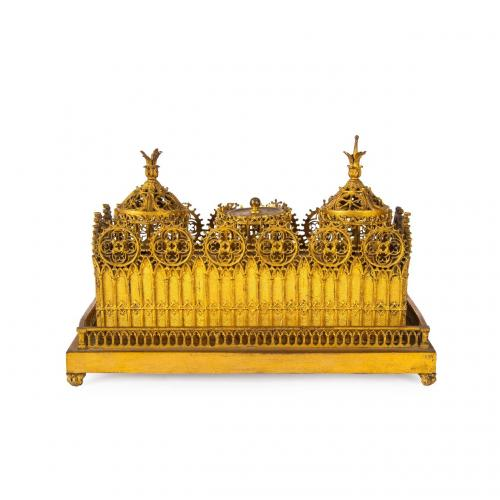 A Victorian gilt brass inkstand cast with Gothic tracery