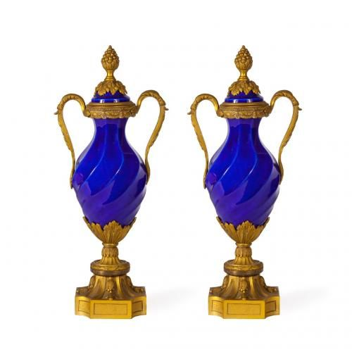 A pair of Louis XVI style blue porcelain ormolu mounted vases with lids