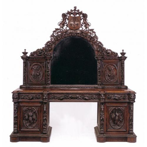 A large and impressive Victorian period carved oak sideboard with arch shaped mirror