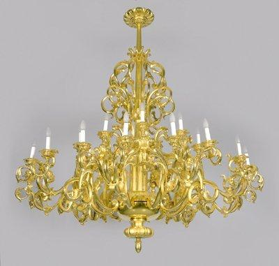 A carved giltwood twenty five light chandelier