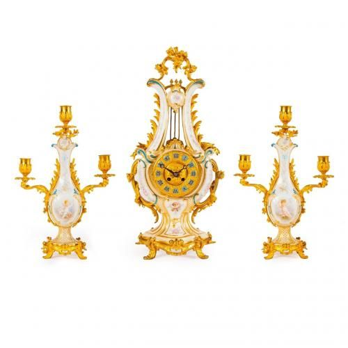 A Sevres style ormolu mounted porcelain clock set