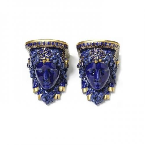 A pair of cobalt-blue glazed porcelain wall brackets