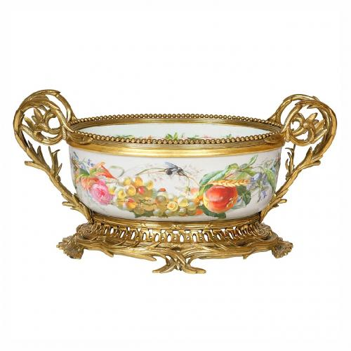 A gilt brass mounted oval porcelain jardiniere centrepiece