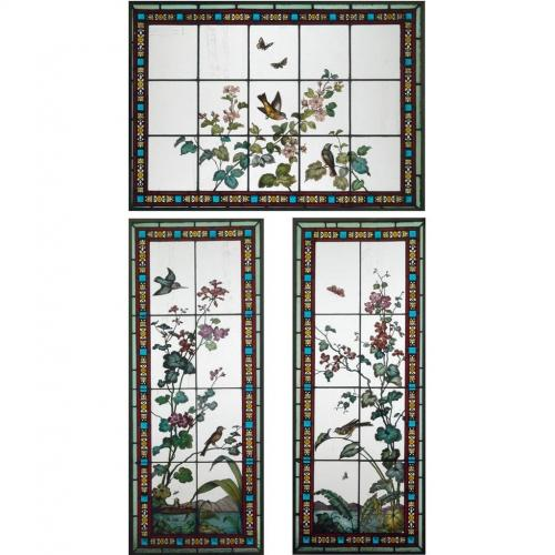 A three piece stained glass window set, by Glasmalerei Geyling