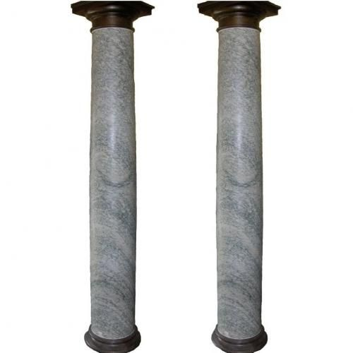 A pair of verte marble and bronze mounted columns, in the Doric style