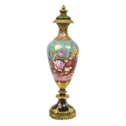 An imposing Royal Bonn porcelain floor vase and cover signed J. Muller