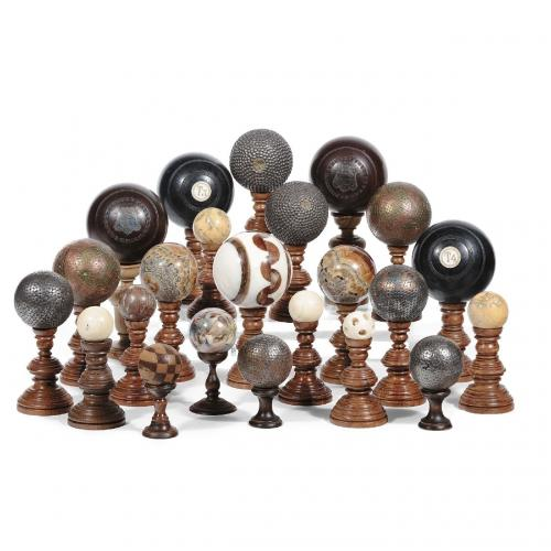 A collection of twenty-three marble and stone spheres