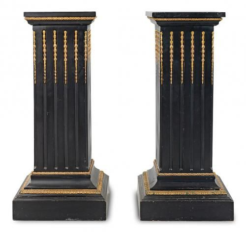 A pair of Louis XVI style ormolu mounted ebonised wood pedestals