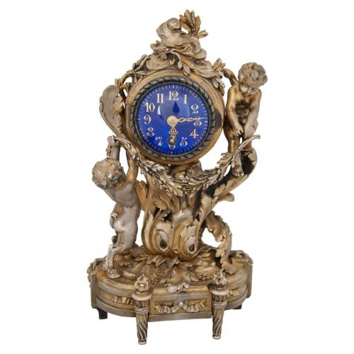 A very fine silver gilt table clock by Ernest Evrot