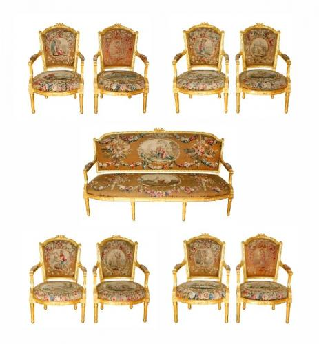 A Louis XVI style giltwood and tapestry nine piece suite