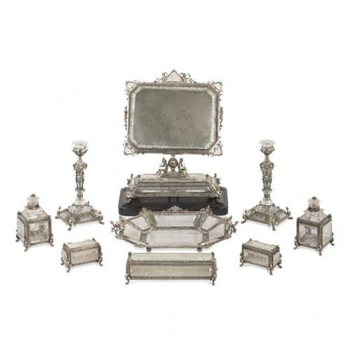 A very fine nine piece rock crystal, silver and enamel toilet set