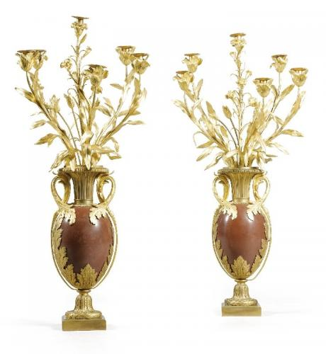 A large pair of Louis XVI style ormolu mounted red marble six light candelabra