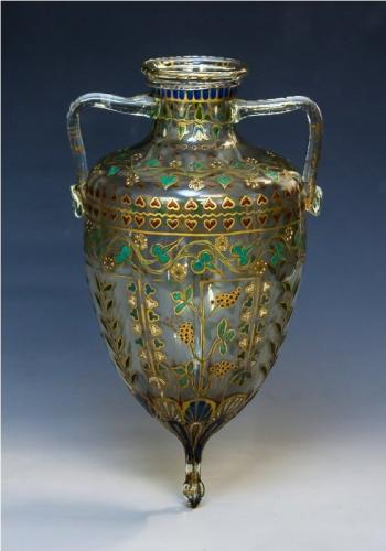 An unusual twin handled enamelled glass amphora vase
