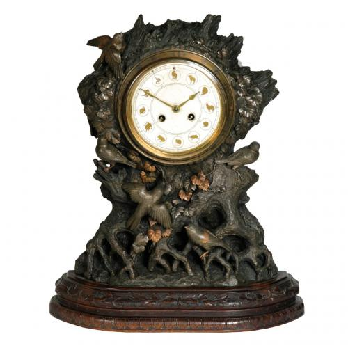 A fine and very unusual patinated bronze mantel clock
