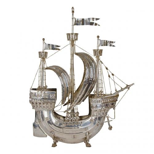 A large silvered model of a ship