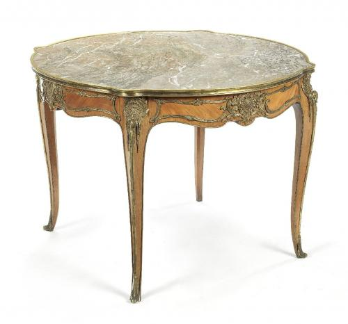 A Louis XV style ormolu mounted rosewood centre table with circular marble top