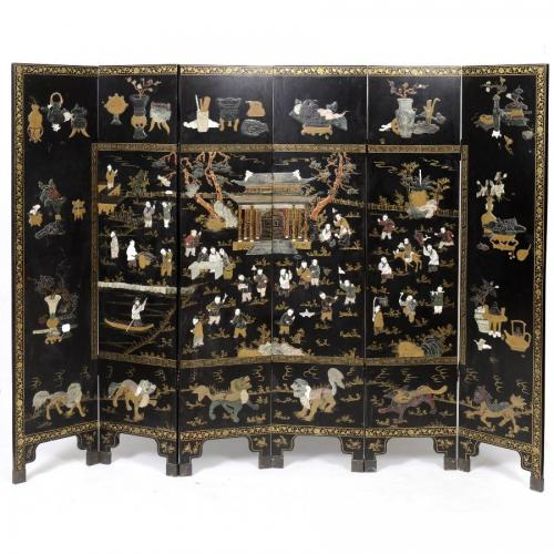 A Qing dynasty ivory and hardstone inlaid black laquer folding screen
