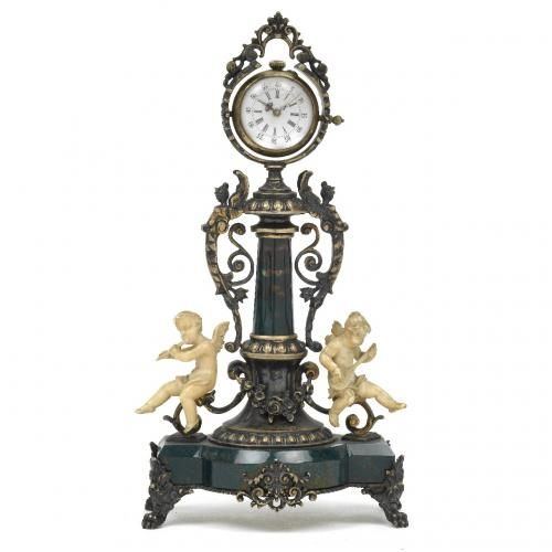 A silver gilt and ivory mounted bloodstone table clock