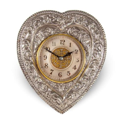 A Victorian heart-shaped silver table clock by Charles Dew Miller