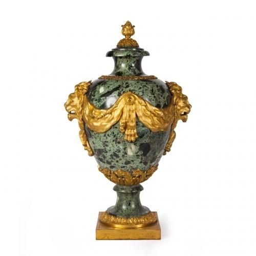 An ormolu mounted green marble vase