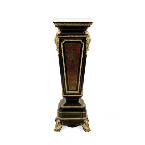 A large ormolu mounted Boulle marquetry ebonised wood pedestal with marble top