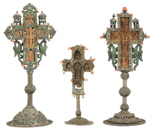 Three coral mounted silver and carved wood crosses