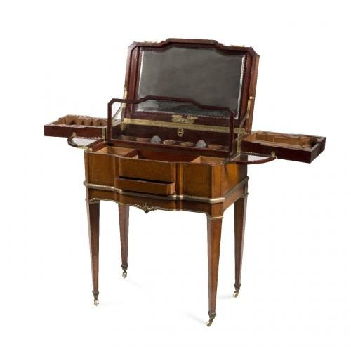 An ormolu mounted burr amboyna and mahogany dressing table