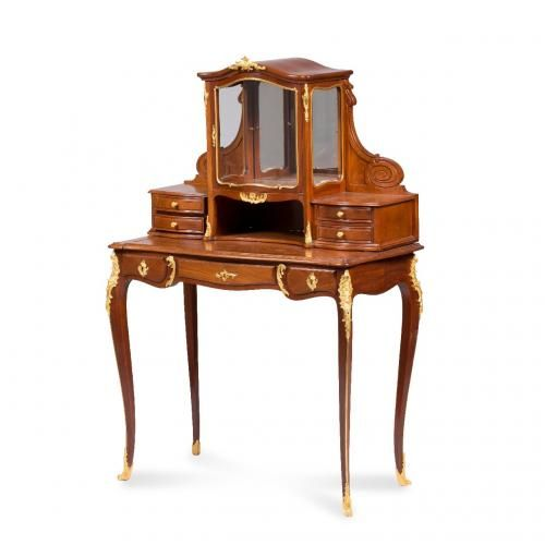 An ormolu mounted mahogany bonheur du jour by Guillaume Grohé