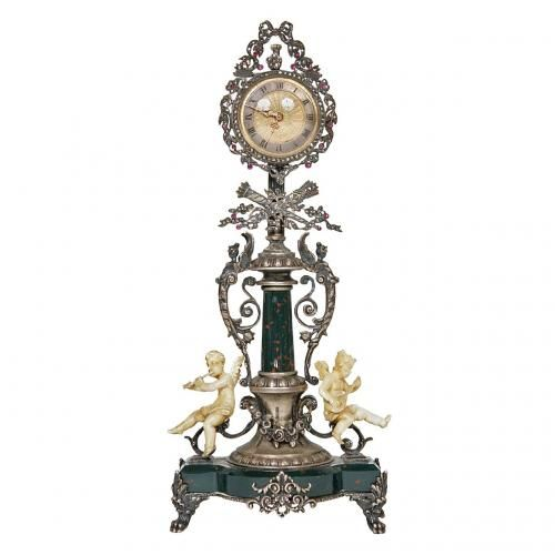 A silver, ivory and bloodstone table clock inset with precious stones