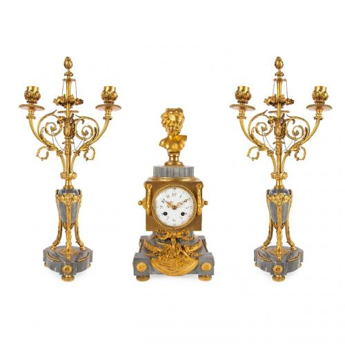 An ormolu mounted grey marble three piece clock set