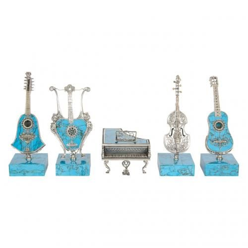A fine set of five miniature silver and turquoise musical instruments