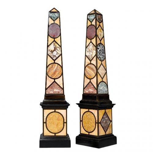 A pair of large ebonised wood and specimen marble obelisks