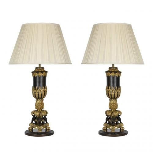 A pair of Empire style gilt and patinated bronze table lamps