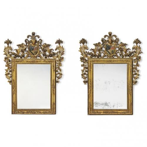 A fine and important pair of polychrome decorated giltwood mirrors